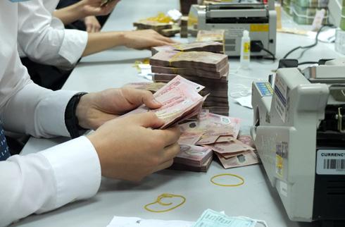 Đại gia ngân hàng hồ hởi báo lãi 6 tháng đầu năm - Ảnh 1