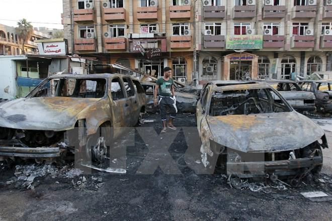 Đánh bom kép liều chết tại thủ đô Baghdad làm 24 người chết - Ảnh 1