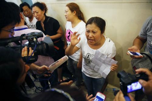 Thân nhân người mất tích trong vụ nổ Thiên Tân phẫn nộ vì thiếu thông tin - Ảnh 1