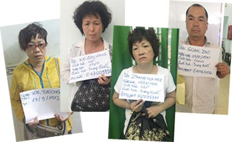Nhóm người Trung Quốc dàn cảnh chữa bệnh bằng bùa phép ở Sài Gòn - Ảnh 1