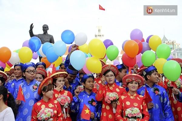 100 cặp uyên ương tham gia đám cưới tập thể trên đường phố Sài Gòn - Ảnh 10