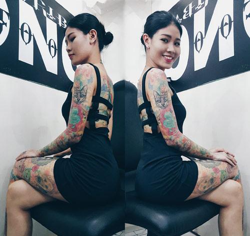 Cô gái xinh đẹp phủ kín cơ thể bằng hình xăm hoạt hình - Ảnh 6