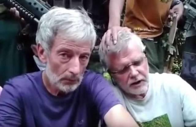Hai con tin Canada ở Philippines cầu cứu vì bị dọa hành quyết - Ảnh 1