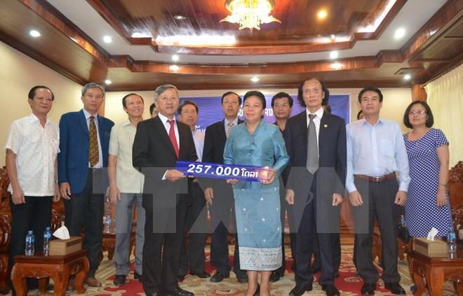 Lào trao 257.000 USD hỗ trợ khắc phục hạn hán, xâm nhập mặn - Ảnh 1