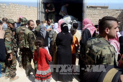 Nga thông báo ngừng bắn, mở hành lang nhân đạo ở Aleppo - Ảnh 1
