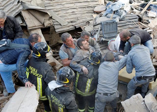 Italy tan hoang sau trận động đất, 21 người thiệt mạng - Ảnh 2