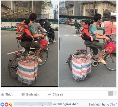 Người cha địu con đạp xe đi nhặt rác gây xúc động - Ảnh 1