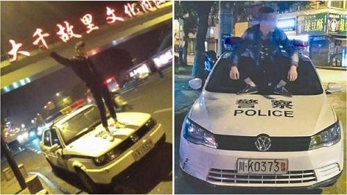 Thanh niên nghịch dại live-stream trên mui xe cảnh sát và cái kết không có hậu - Ảnh 1