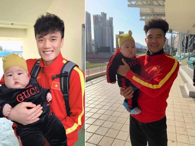 Danh tính em bé được các cầu thủ U23 Việt Nam ở Hàn Quốc tranh nhau bế chụp ảnh - Ảnh 2