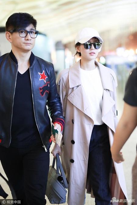 Lưu Thi Thi tóc ngắn lạ lẫm, được Ngô Kỳ Long hộ tống đi dự Milan Fashion Week - Ảnh 3