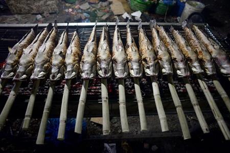 TP.HCM: Phố cá lóc nướng hoạt động suốt đêm phục vụ ngày vía Thần tài - Ảnh 5