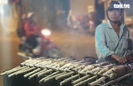 TP.HCM: Phố cá lóc nướng hoạt động suốt đêm phục vụ ngày vía Thần tài - Ảnh 8
