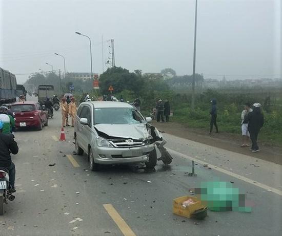 Ô tô 7 chỗ va chạm xe máy, 2 người tử vong tại chỗ - Ảnh 1
