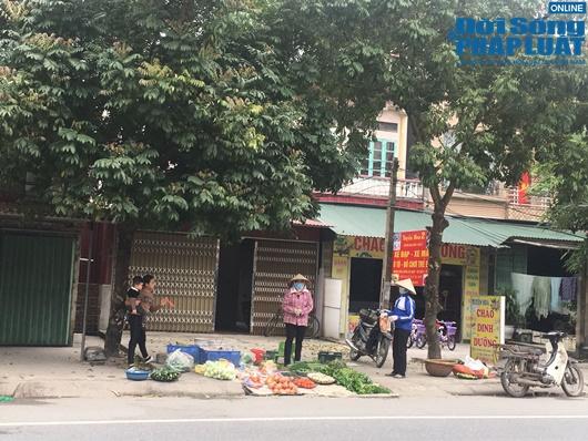 Đường phố vắng vẻ từ thành thị đến nông thôn, người dân nghiêm túc thực hiện cách ly xã hội - Ảnh 17