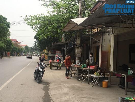 Đường phố vắng vẻ từ thành thị đến nông thôn, người dân nghiêm túc thực hiện cách ly xã hội - Ảnh 16