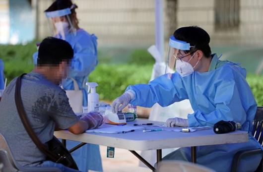 Lo ngại Covid-19 một lần nữa bùng phát ở Hàn Quốc vì lây nhiễm ở nhà thờ - Ảnh 1
