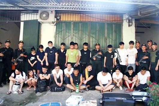 Lào Cai: Bắt giữ 21 đối tượng lừa đảo, trốn truy nã người Trung Quốc - Ảnh 1