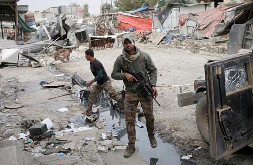 Iraq: IS giết hàng chục dân thường ở Mosul để ngăn chặn hỗ trợ quân đội - Ảnh 1