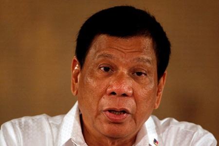 Tổng thống Philippines nói không thể cản Trung Quốc xây dựng ở Scarborough - Ảnh 1