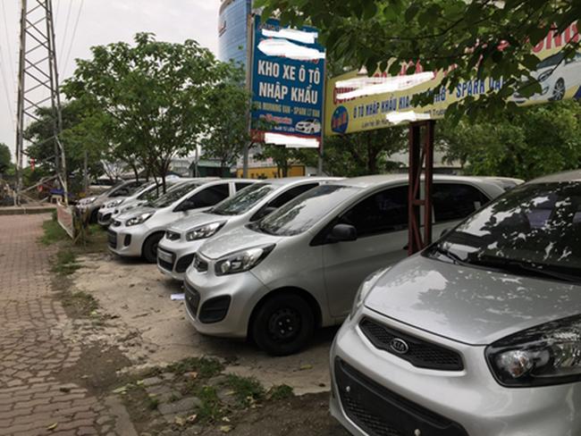 Đại lý ô tô trong cơn bão giảm giá: Nơi dùng chiêu trò, nơi đóng cửa dừng hoạt động - Ảnh 1