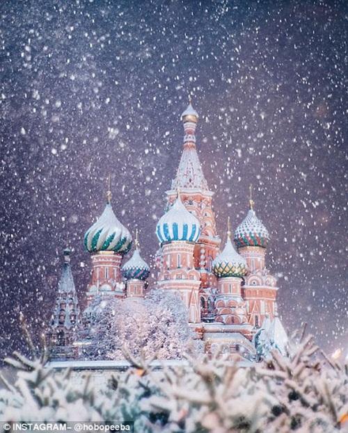 Mê mẩn cảnh tuyết rơi trắng xóa ở Nga - Ảnh 10