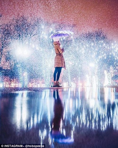 Mê mẩn cảnh tuyết rơi trắng xóa ở Nga - Ảnh 12