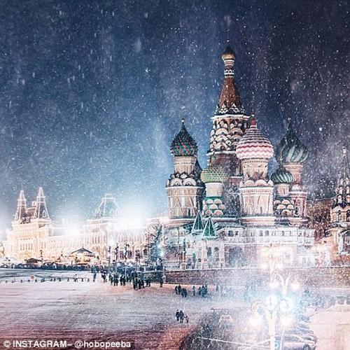 Mê mẩn cảnh tuyết rơi trắng xóa ở Nga - Ảnh 5