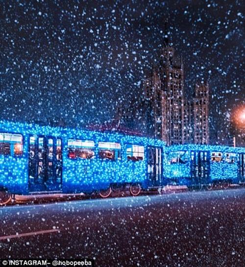 Mê mẩn cảnh tuyết rơi trắng xóa ở Nga - Ảnh 7