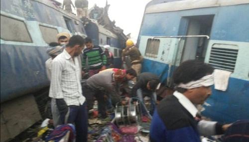 Số người chết trong tai nạn tàu hỏa ở Ấn Độ lên đến 120 người - Ảnh 1