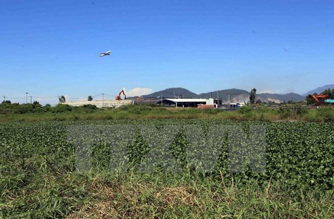 Bàn giao 12,7 ha đất nhiễm dioxin đã xử lý để mở rộng sân bay Đà Nẵng - Ảnh 1