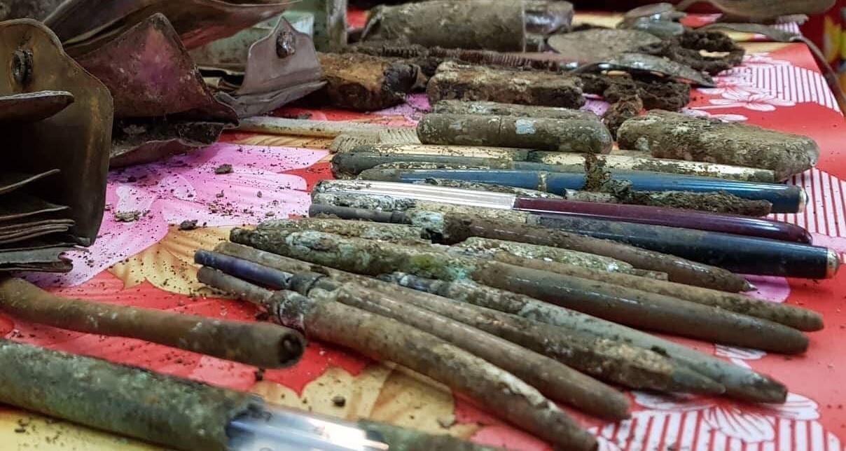 Bức ảnh chân dung cùng nhiều di vật của 13 liệt sĩ dưới hố chôn tập thể ở Đồng Nai - Ảnh 2