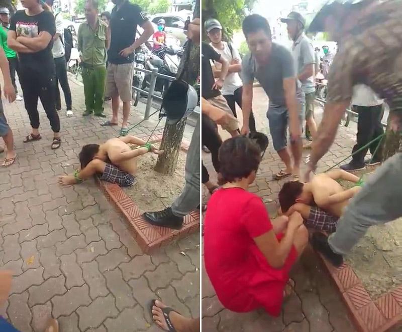 Hà Nội: Thiếu niên đánh giày bị trói tay chân vào gốc cây gần công viên Thống Nhất - Ảnh 1
