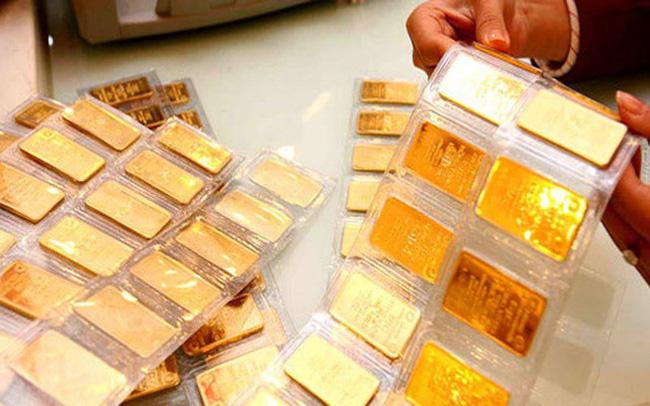 Giá vàng hôm nay 25/11: Giá vàng SJC lao dốc, giảm 600.000 đồng/lượng - Ảnh 1