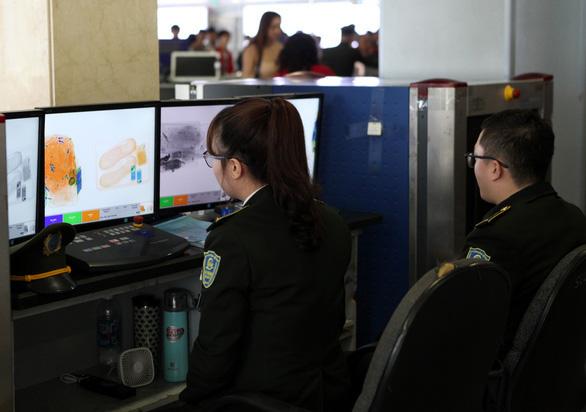 Phát hiện một nữ hành khách mang súng bút lắp sẵn đạn lên máy bay - Ảnh 1