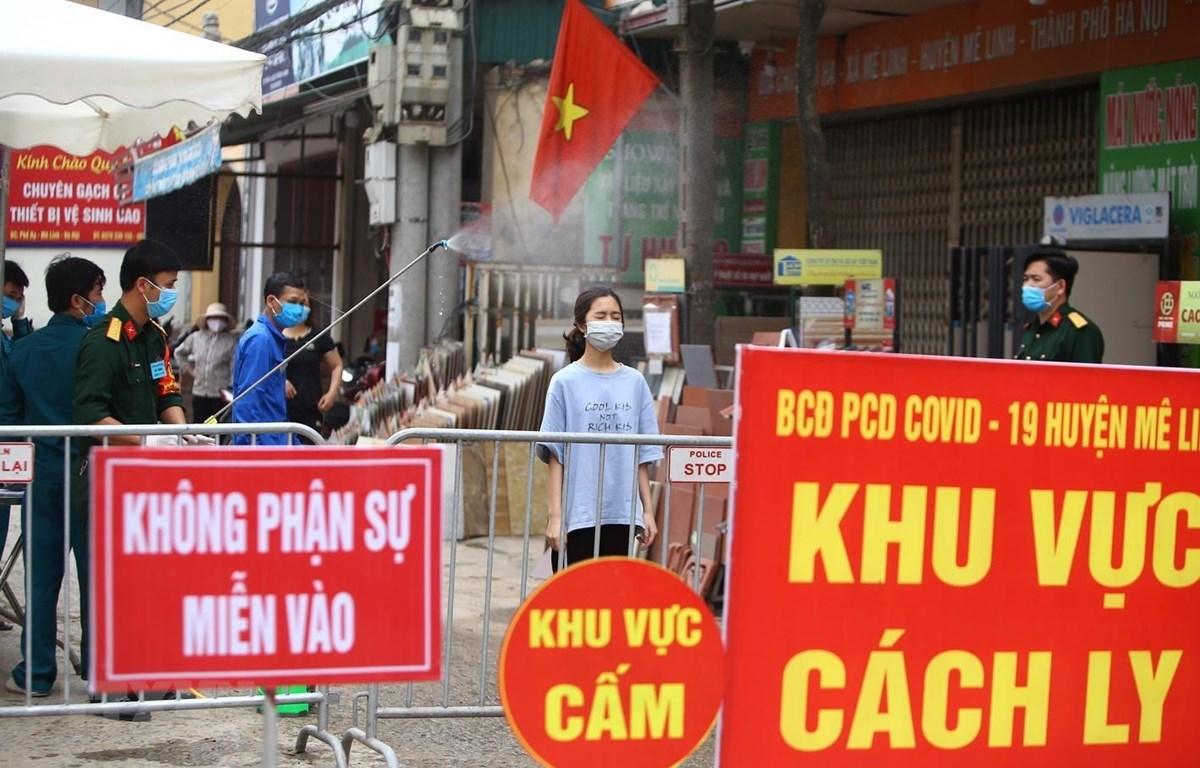 Ông Nguyễn Đức Chung và dấu ấn trong phòng chống COVID-19 - Ảnh 1