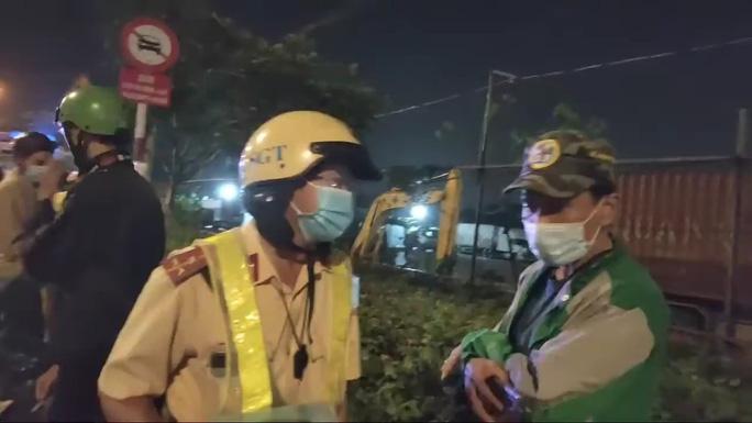 """Công an vào cuộc vụ nhóm người quay video """"giám sát CSGT"""" ở TP.HCM - Ảnh 1"""