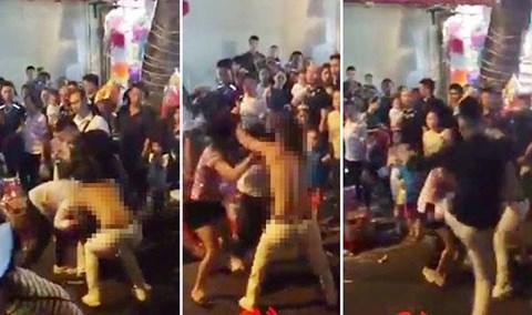 Điều tra vụ cô gái bị giật tung áo trên phố Hàng Mã đêm Trung thu - Ảnh 1