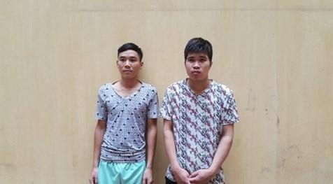 2 thanh niên lăng mạ, lao thẳng xe vào CSGT bị khởi tố - Ảnh 1
