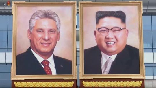Bức chân dung chính thức đầu tiên nhà lãnh đạo Triều Tiên Kim Jong-un - Ảnh 1