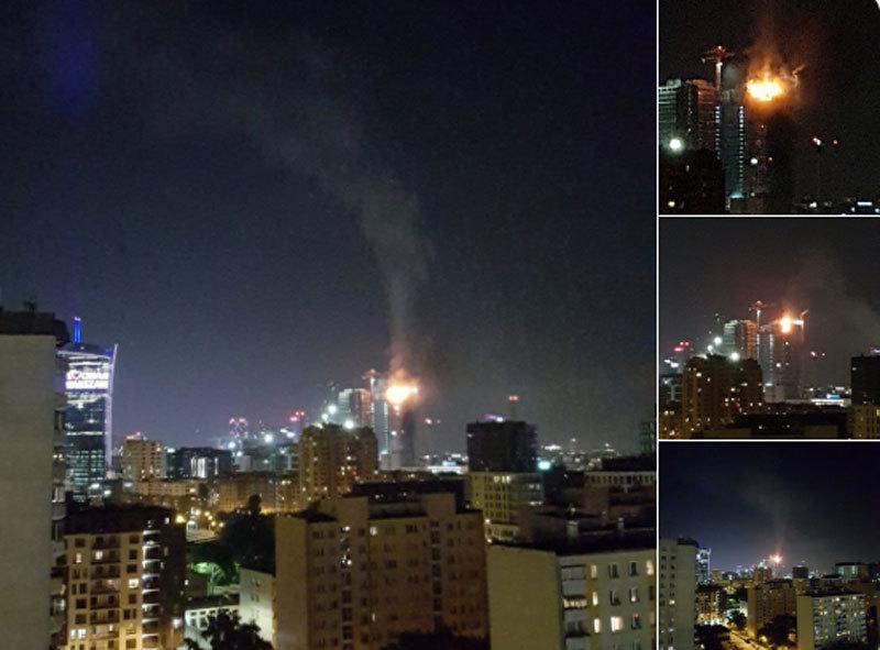 Khoảnh khắc tòa tháp chọc trời Ba Lan bốc cháy dữ dội trong đêm - Ảnh 2