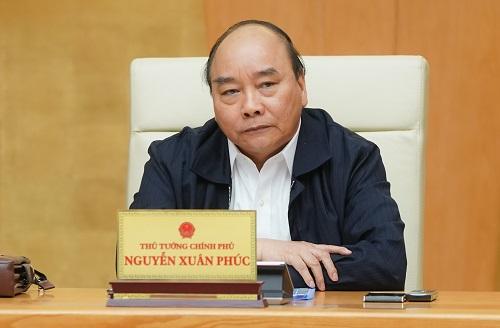 Thủ tướng yêu cầu người dân Hà Nội và TP.HCM phải đeo khẩu trang nơi công cộng - Ảnh 1