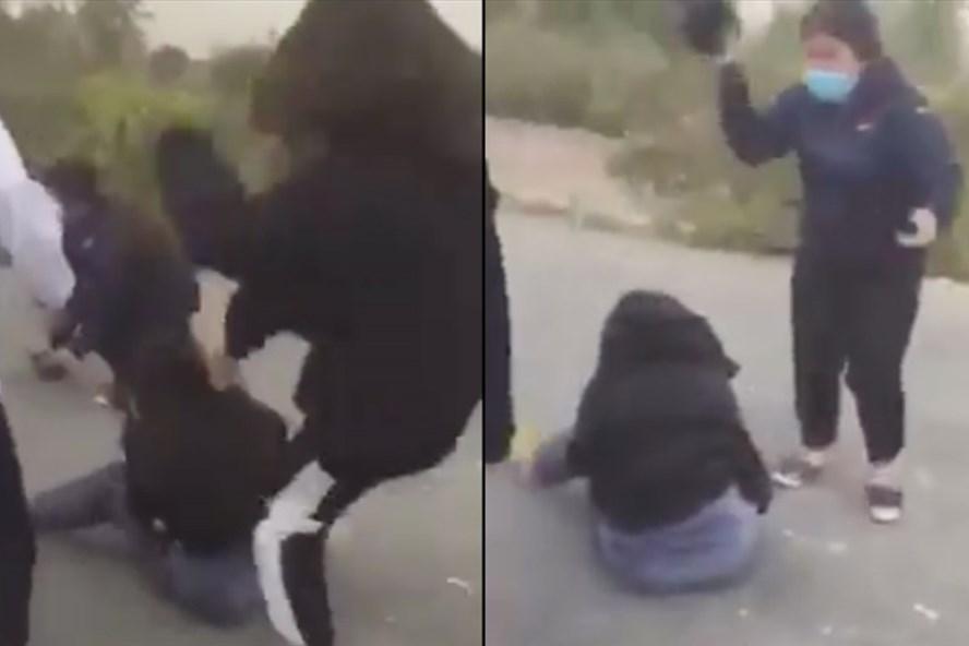 Vụ clip cô gái trẻ bị nhóm người đập mũ bảo hiểm vào đầu ở Hà Nội: Hé lộ nguyên nhân - Ảnh 1