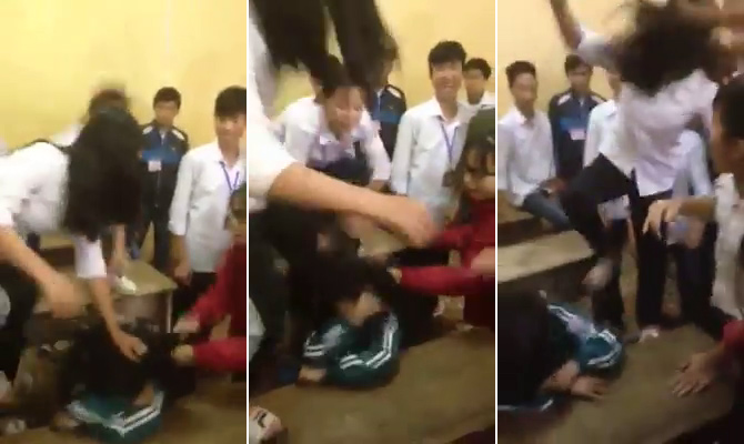 Bất ngờ với lý do nữ sinh bị đánh hội đồng ngay trong lớp học - Ảnh 1