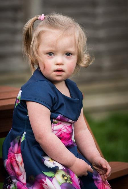 Bé gái 2 tuổi bị Down trở thành mẫu ảnh của nhãn hàng thời trang trẻ em - Ảnh 4
