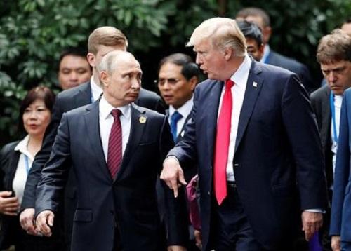Gặp nhanh ở APEC, Tổng thống Trump tin ông Putin không can dự bầu cử Mỹ - Ảnh 1