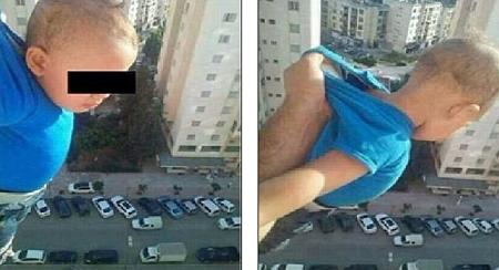 """Treo con ngoài cửa sổ tầng 15 để """"câu"""" like Facebook, bố lãnh án tù - Ảnh 1"""