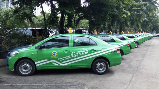 Vụ Grab mua lại Uber: Taxi truyền thống giục Bộ Công Thương sớm ra kết luận  - Ảnh 2