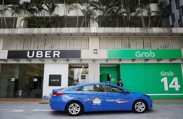 Vụ Grab mua lại Uber: Taxi truyền thống giục Bộ Công Thương sớm ra kết luận  - Ảnh 1