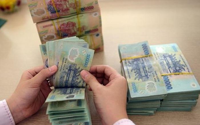 Ngân hàng Nhà nước siết giải ngân vốn vay bằng tiền mặt - Ảnh 1