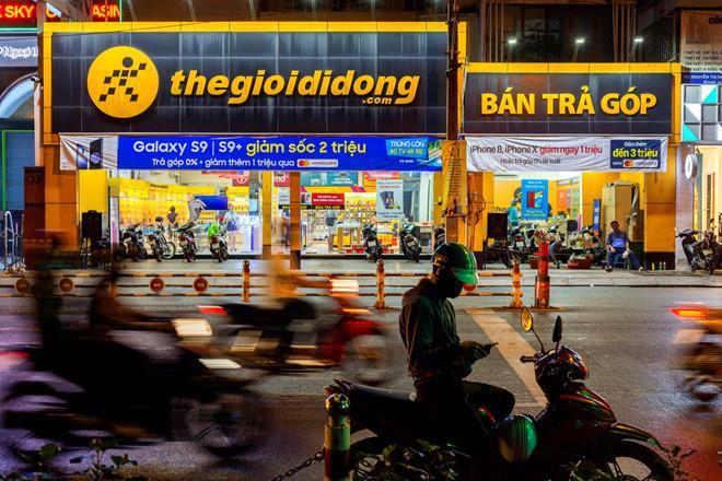 Thế Giới Di Động của ông Nguyễn Đức Tài 'oằn mình' gánh nợ đến 13.000 tỷ - Ảnh 1